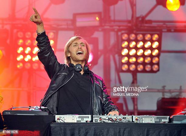 French DJ David Guetta performs on a stage set up by French TV channel France 2 at Auteuil racecourse on June 21 2008 in Paris as part of the music...