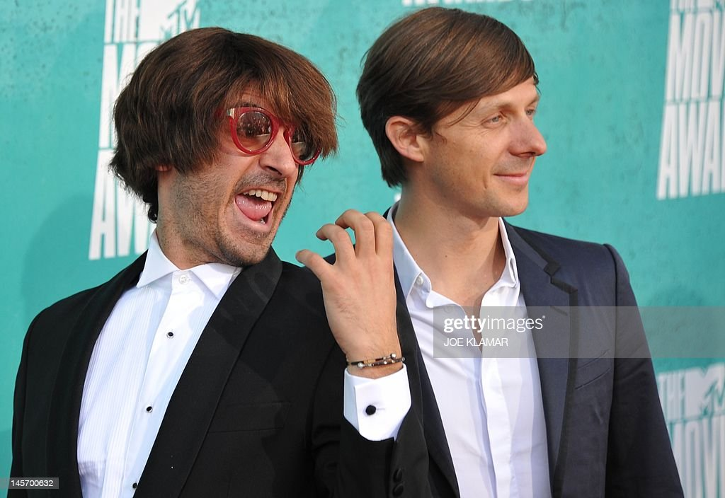 French DJ Martin Solveig (R) arrives with his manager 'Sidekick Lafaille' (L) at the MTV Movie Awards at Universal Studios, in Los Angeles, California, on June 3, 2012.