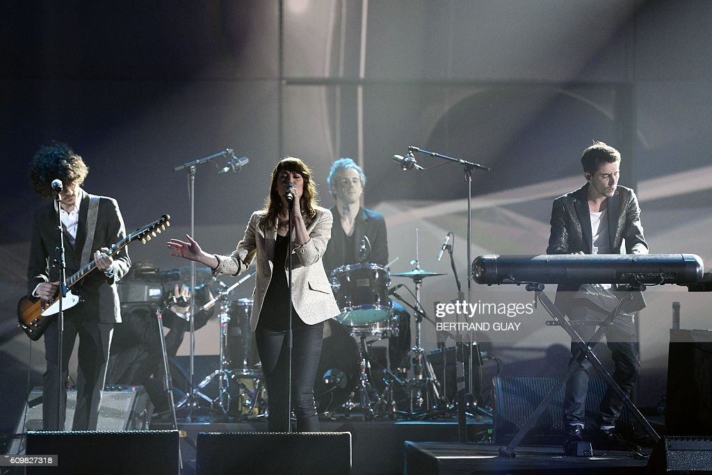 French DJ Tristan Casara aka The Avener (R) and French singer Phoebe Tolmer known as Phoebe Killdeer (C) perform during the 31st Victoires de la Musique, the annual French music awards ceremony, on February 12, 2016 at the Zenith concert hall in Paris. AFP PHOTO / BERTRAND GUAY / AFP / BERTRAND GUAY