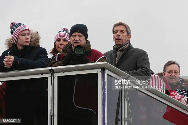 French doctor and television host Michel Cymes looks on during the 97th Prix d'Amerique equestrian trotting world championship at the ParisVincennes...