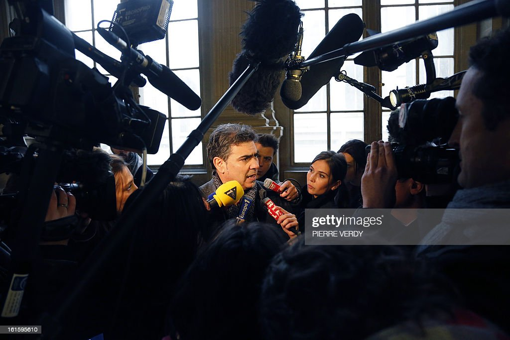 French doctor Philippe Van Winkelberg speaks to journalists at the Paris courthouse on February 12, 2013, after the deliberation in the trial of members of former French charity organisation Arche de Zoe (Zoe's Ark), accused of illegal involvement in adoption procedures. The court sentenced two French aid workers to two years in jail for attempting to illegally bring 103 children from Chad to France for adoption, falsely claiming they were orphans from Darfur. Eric Breteau, who founded the Zoe's Ark charity that was involved in the failed attempt, and his partner Emilie Lelouch, were tried in absentia after refusing to show up for the proceedings.