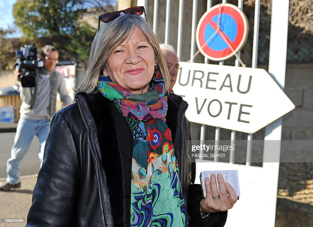 French Dolores Roque, member of the PS, the socialist ruling party, candidate for her reelection as member of Parliament, in the Herault 6th constituency, arrives to the polling station to vote, in Beziers, southern France, before voting on December 9, 2012. French Conseil Constitutionnel, one of the country's highest courts, cancelled her precedent election due to 23 irregular proxy vote forms.
