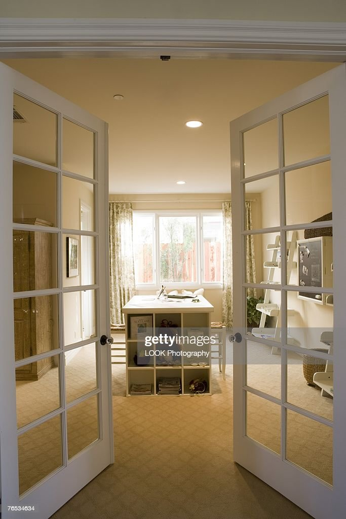 French doors open to artroom stock photo getty images for French doors that both open