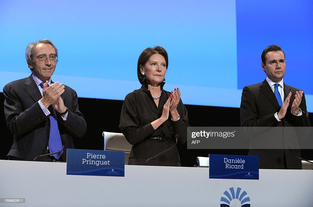 French drinks group Pernod Ricard CEO Pierre Pringuet, Chairman of the Board, Daniele Ricard and Deputy CEO and Chief Operating Officer Alexandre Ricard applaud to pay tribute to Patrick Ricard during the group's general meeting in Paris on November 9, 2012.