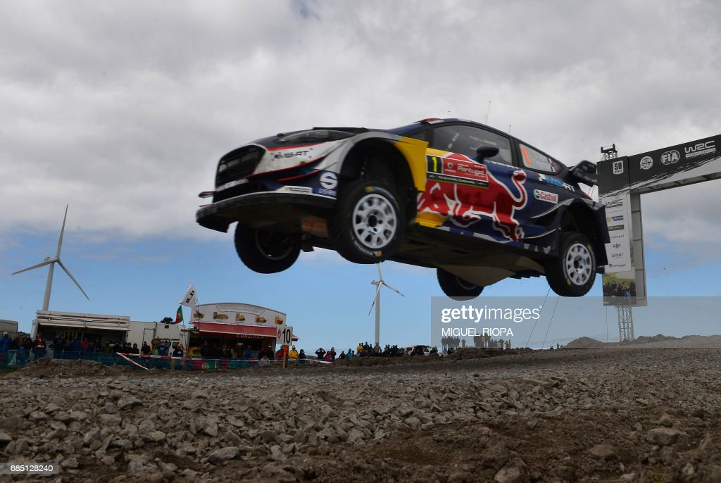 French driver and co-driver, Sebastien Ogier and Julien Ingrassia, steer their Ford Fiesta WRC in Viana do Castelo, northern Portugal, on May 19, 2017, during the first stage of the Portugal WCR rally. /