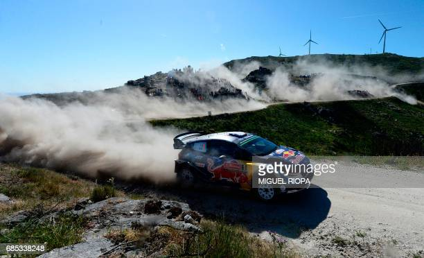 TOPSHOT French driver and codriver Sebastien Ogier and Julien Ingrassia steer their Ford Fiesta WRC in Caminha northern Portugal on May 19 during the...