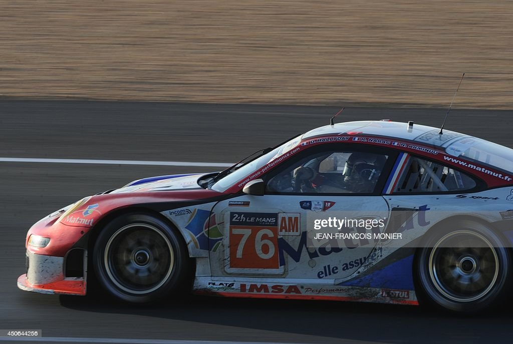 French driver David Halliday in his Porsche 911 GT3RSR N°76 competes during the 82nd Le Mans 24 hours endurance race, on June 15, 2014 in Le Mans, western France. Fifty-six cars with 168 drivers are participating on June 14 and 15 in the Le Mans 24-hours endurance race. AFP PHOTO / JEAN FRANCOIS MONIER