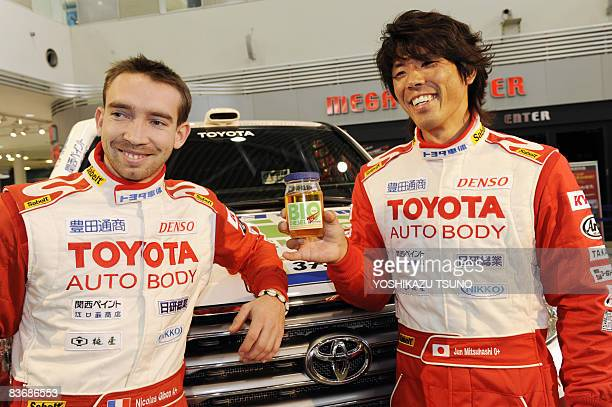 French driver Nicolas Gibon and Japanese driver Jun Mitsuhashi display recycled biodiesel fuel made from used tempura cooking oil at a press...