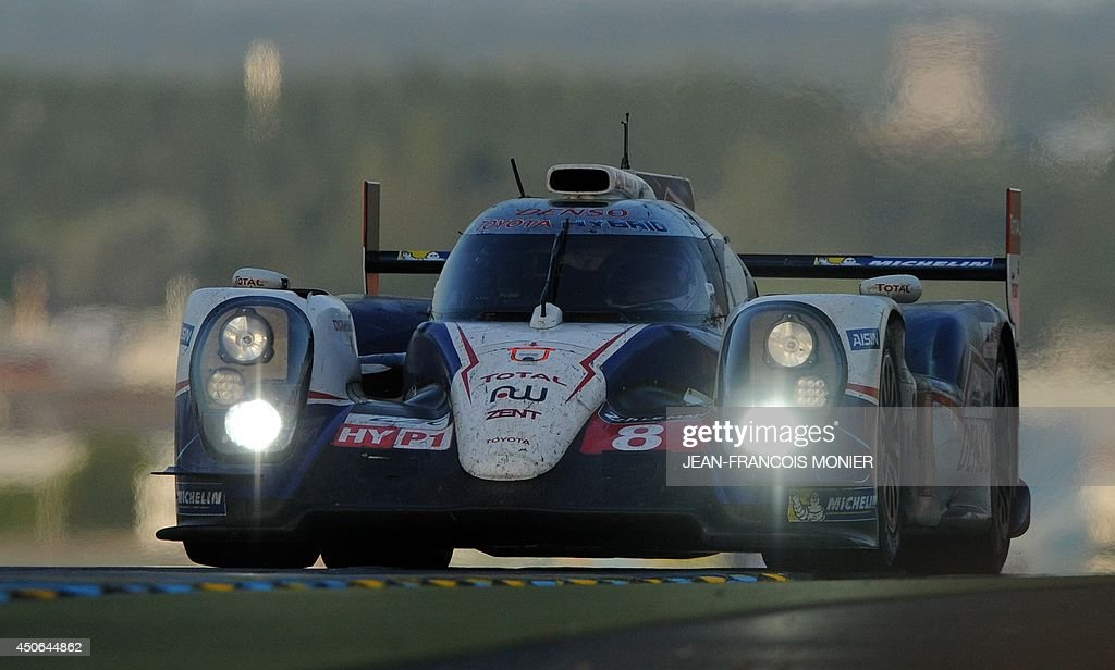 French driver Nicolas Lapierre in his Toyota TS 040 Hybrid N° 8 competes during the 82nd Le Mans 24 hours endurance race, on June 15, 2014 in Le Mans, western France. Fifty-six cars with 168 drivers are participating on June 14 and 15 in the Le Mans 24-hours endurance race. AFP PHOTO / JEAN FRANCOIS MONIER