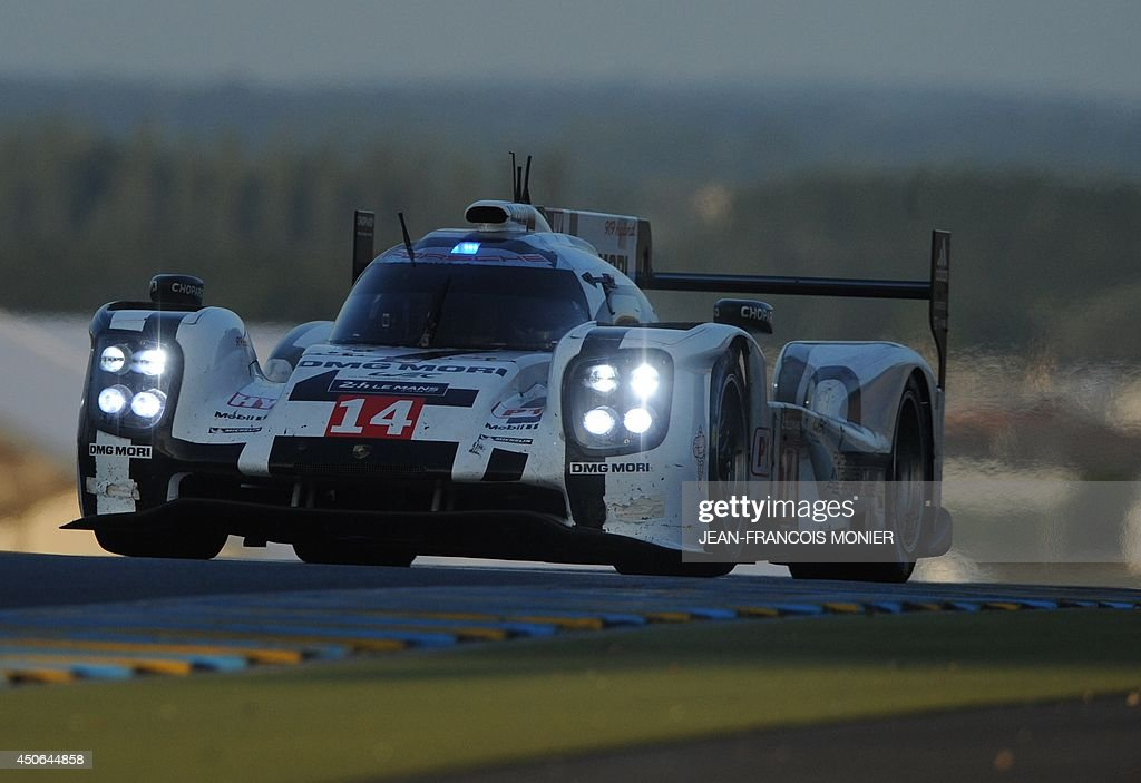 French driver Romain Dumas in his Porsche 919 Hybrid N° 14 competes during the 82nd Le Mans 24 hours endurance race, on June 15, 2014 in Le Mans, western France. Fifty-six cars with 168 drivers are participating on June 14 and 15 in the Le Mans 24-hours endurance race.