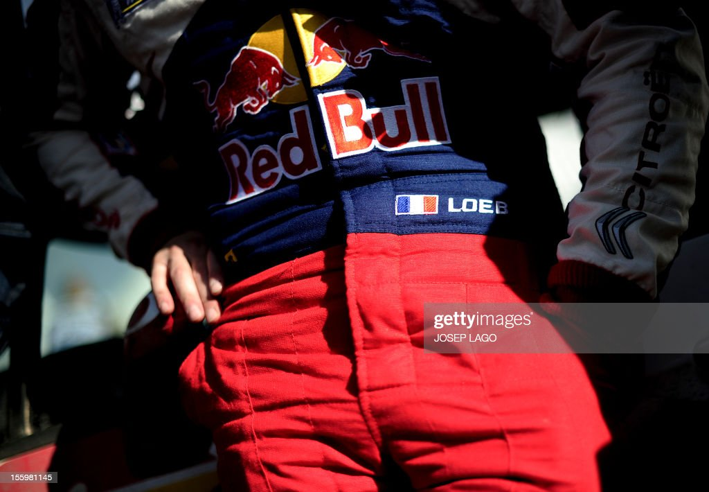 French driver Sebastien Loeb stands on the technical park during the second stage of the 48th Rally of Catalonia in Salou near Tarragona, on November 10, 2012.
