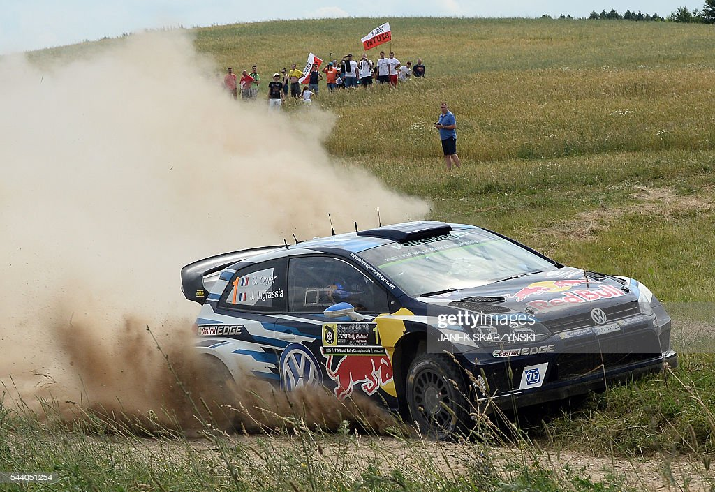 French driver Sebastien Ogier and French co-driver Julien Ingrassia drive their Hyundai i20 WRC during the special stage of The Rally of Poland in Stare Juchy, north of Poland on July 1, 2016. / AFP / JANEK