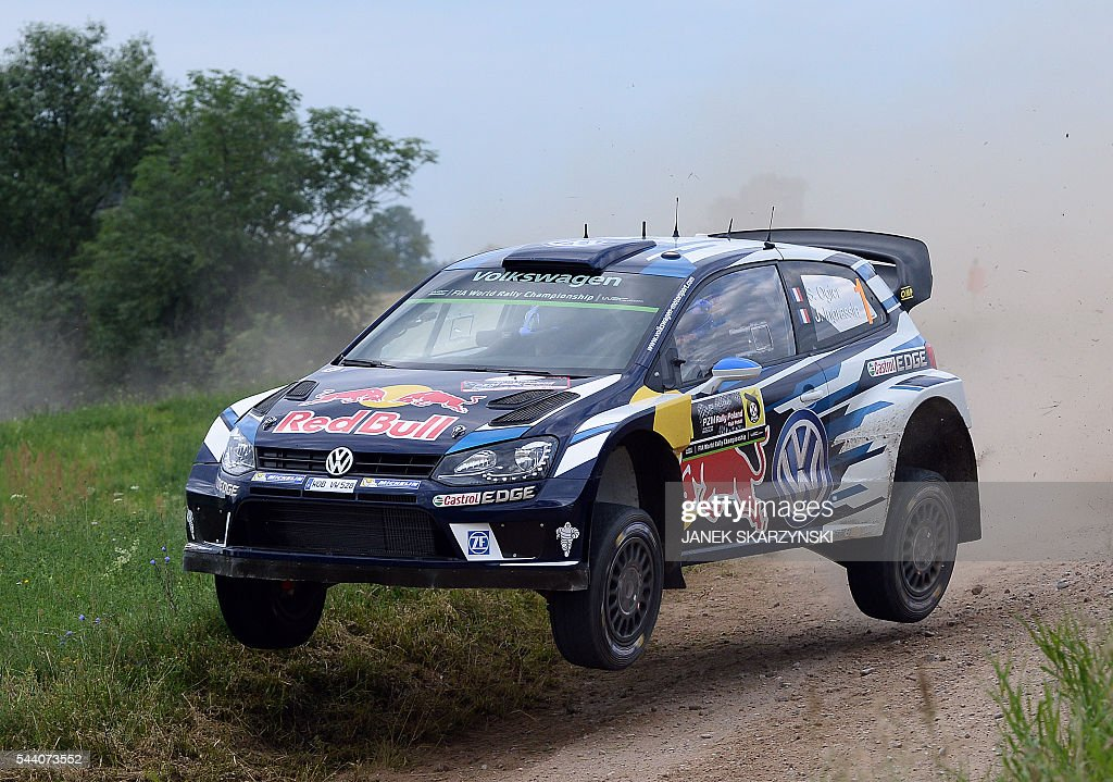 French driver Sebastien Ogier and French co-driver Julien Ingrassia drive their Volkswagen Polo R WRC during the special stage of The Rally of Poland in Chmielewo, north of Poland on July 1, 2016. / AFP / JANEK