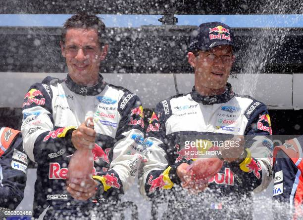 French driver Sebastien Ogier and French codriver Julien Ingrassia celebrate winning on the podium of the the SS19 stage on the last day of the...