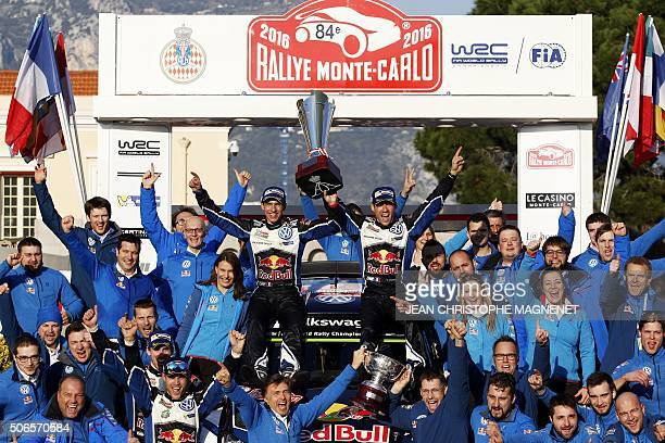 French driver Sebastien Ogier and his codriver Julien Ingrassia celebrate their victory during the podium ceremony for the 84th MonteCarlo Rallye on...