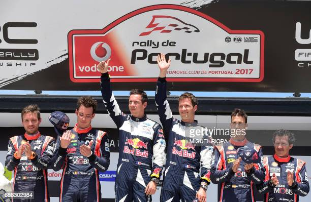 French driver Sebastien Ogier celebrates winning on the podium of the the SS19 stage beside Belgian codriver Nicolas Gilsoul Belgian driver Thierry...