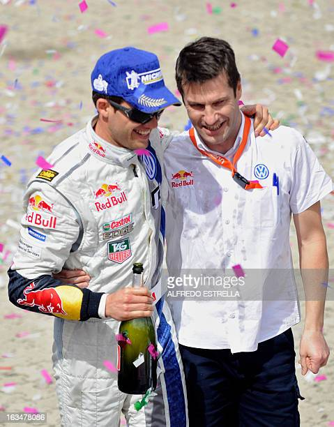 French driver Sebastien Ogier celebrates with Volkswagen Motorsport team manager Jost Capito after winning the FIA World Rally Championship in Leon...