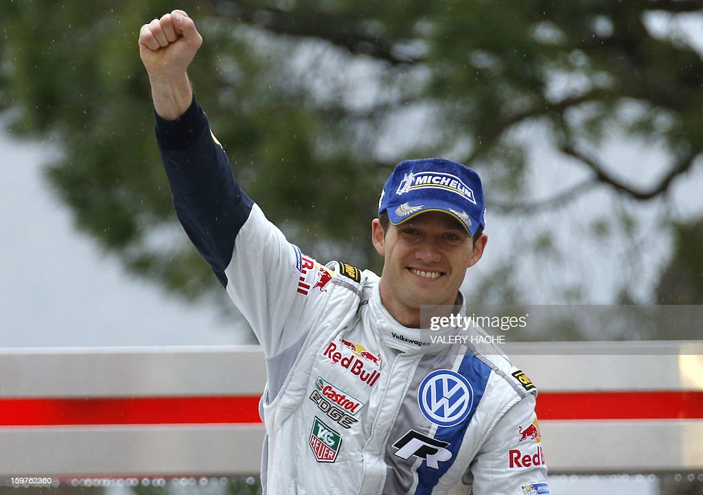 French driver Sebastien Ogier waves after finishing second of the Monte-Carlo rallye race, opening stage of the World Rally Championship, on January 20, 2013 in Monaco. World champion Sebastian Loeb, in a Citroen, clinched a seventh Monte Carlo Rally title after heavy snow and driving rain caused the race's last two stages to be cancelled.