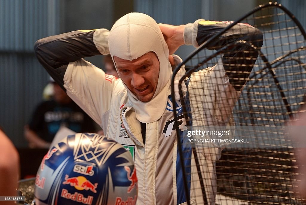 French driver Sebastien Ogier wears a head guard during a warm-up for the Race of Champions (ROC) at Rajamangala Stadium in Bangkok on December 16, 2012. The Race of Champions (ROC) will take place in Thailand between December 14 and 16 and brings together heavyweights from all motor racing disciplines in the same type of car.