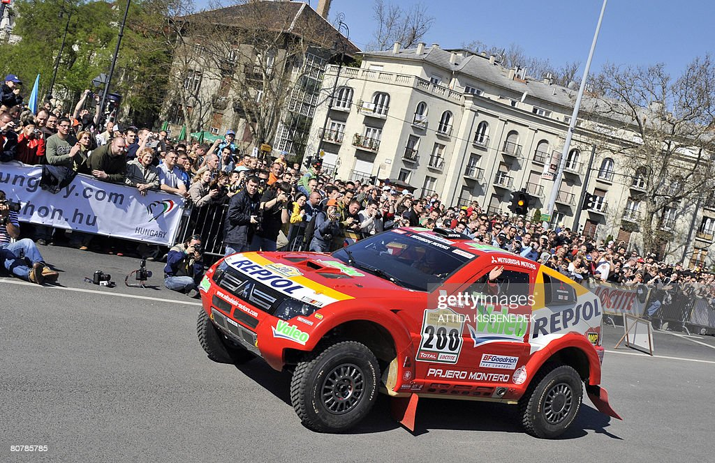 French driver Steph Peterhansel and copilot JeanPaul Cottret of Repsol Mitsubishi Ralliart team leave the starting podium of the The Central European...