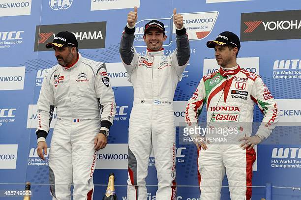 French driver Yvan Muller Argentine driver Jose Maria Lopez and Portuguese driver Tiago Montero pose on the podium after the 2nd race of the FIA...