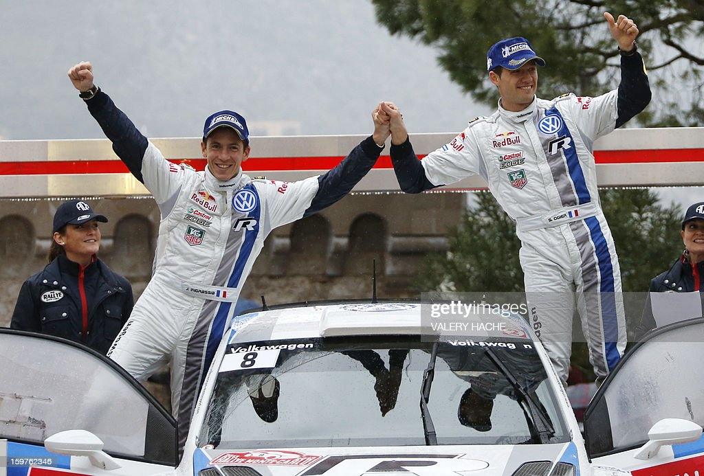 French drivers Julien Ingrassia (L) and Sebastien Ogier (R) celebrate after finishing second of the Monte-Carlo rallye race, opening stage of the World Rally Championship, on January 20, 2013 in Monaco. World champion Sebastian Loeb, in a Citroen, clinched a seventh Monte Carlo Rally title after heavy snow and driving rain caused the race's last two stages to be cancelled. AFP PHOTO / VALERY HACHE