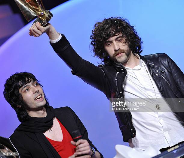 French duo Justice's members react after receiving the best electronic band or artist of the year award during the 23rd Victoires de la Musique...
