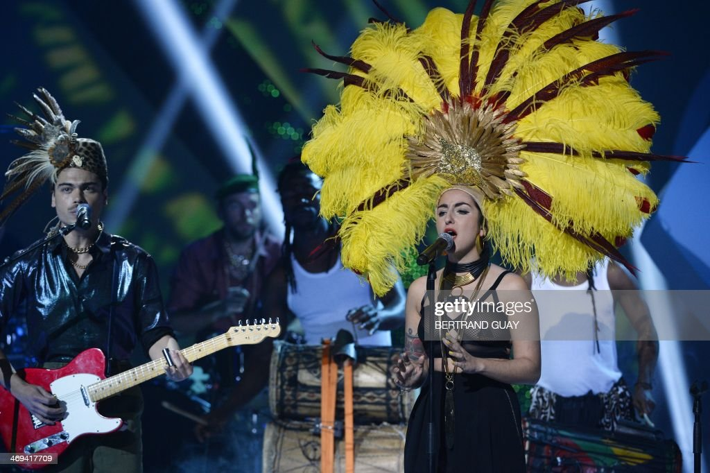 French Duo Lilly Wood and the Prick, made up of French-Israeli singer Nili Hadida (R) and French guitarist Benjamin Cotto (L), perform on stage during the 29th Victoires de la Musique, the annual French music awards ceremony, on February 14, 2014 at the Zenith concert hall in Paris.