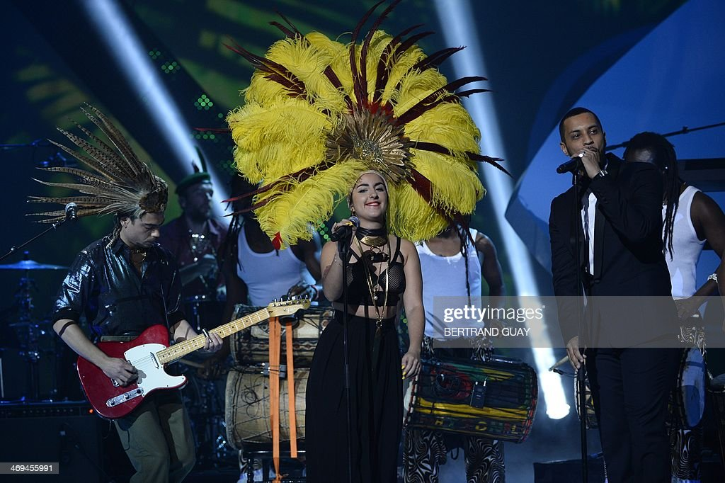 French Duo Lilly Wood and the Prick, made up of French-Israeli singer Nili Hadida (C) and French guitarist Benjamin Cotto (L), perform on stage during the 29th Victoires de la Musique, the annual French music awards ceremony, on February 14, 2014 at the Zenith concert hall in Paris.