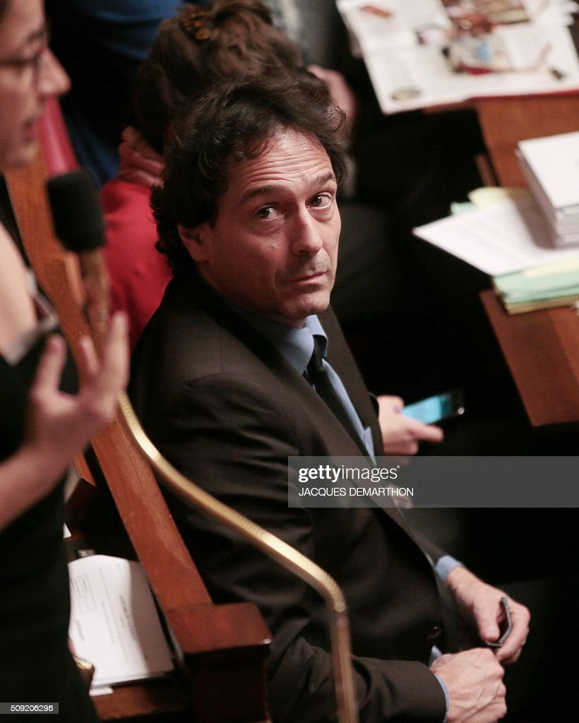 French ecologist EELV party MP Christophe Cavard attends the debate at the French National Assembly in Paris on February 9, 2016, as French lawmakers examined proposed changes to the constitution. France's lower house of parliament is to vote on plans to enshrine a state of emergency into the constitution, including a controversial measure to strip French nationality from those convicted of terrorism and serious crimes. / AFP / JACQUES DEMARTHON