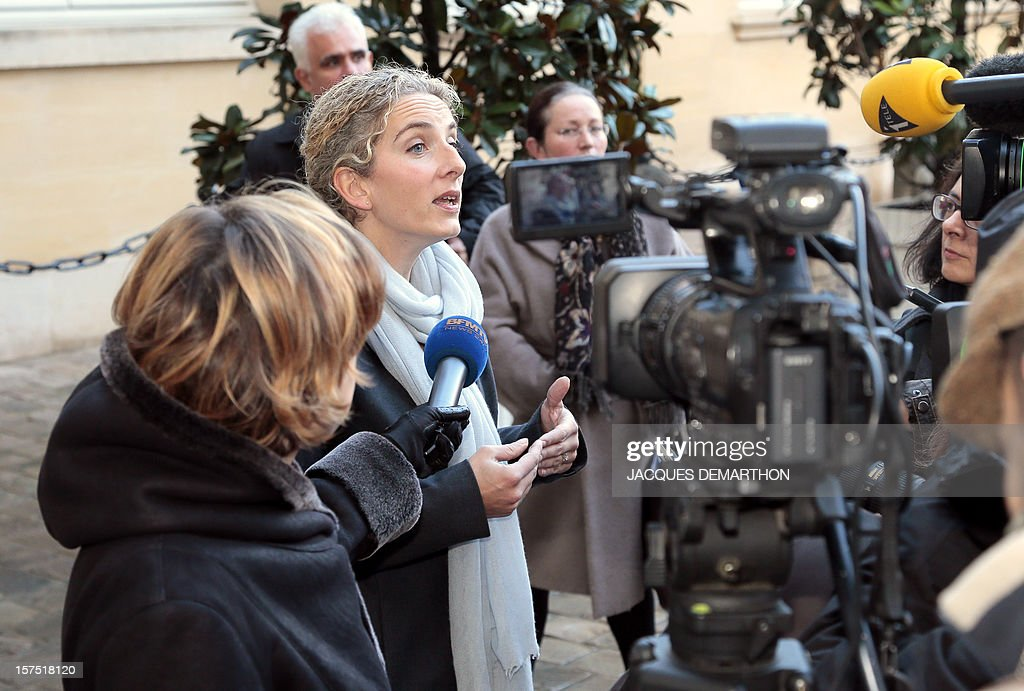 French Ecology Minister Delphine Batho (C) gives a press conference outside the Prime Minister's official residence Hotel Matignon, in Paris, on December 4, 2012, after participating in a goverment seminar focused on ecological transition.