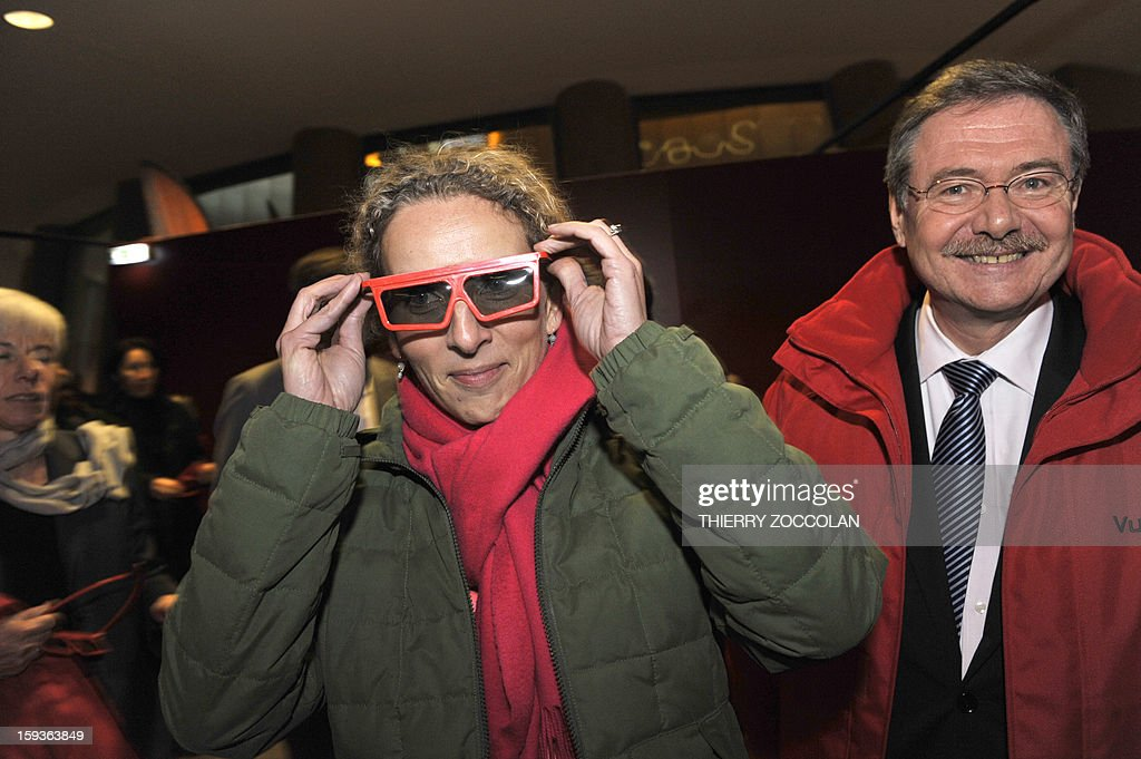 French Ecology Minister, Delphine Batho, tries 3D glasses next to the president of the volcanism park Vulcania Jean Mallot (R), after a visit of the Chaine des Puys, a volcanic chain in the French Massif Central, in Saint-Ours, on January 11, 2013. The Chaine des Puys will be registered on the list of UNESCO's World Heritage sites.