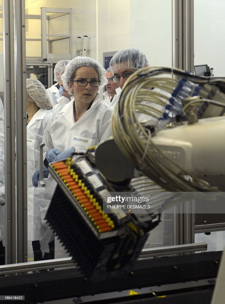 French Ecology Minister Delphine Batho visits French solar panel maker PhotoWatt factory on January 31, 2013 in Bourgoin-Jallieu, near Lyon.