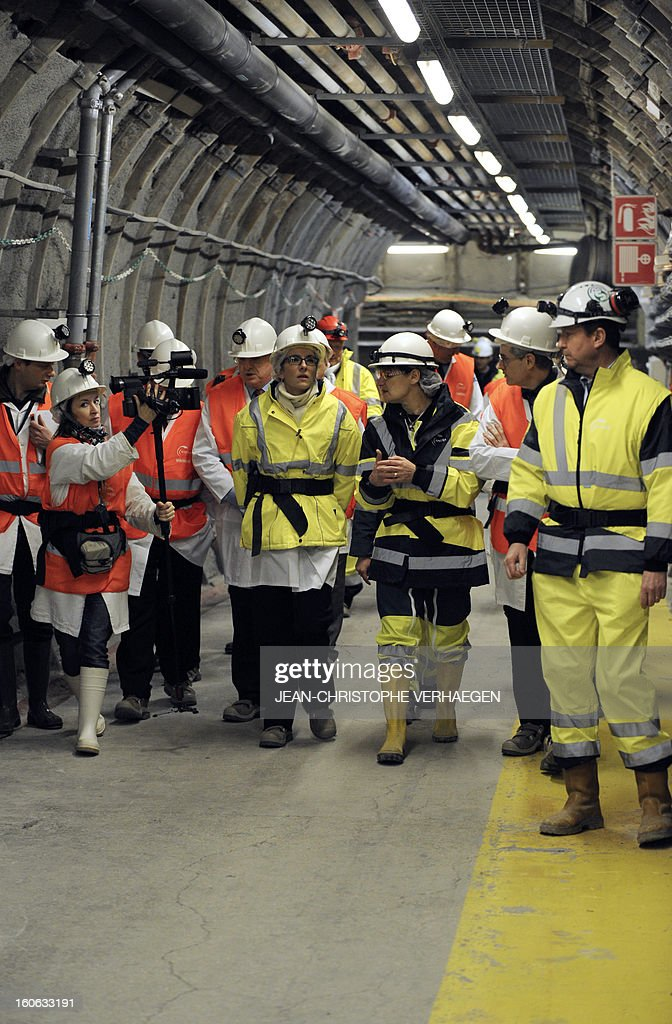 French Ecology Minister Delphine Batho (C) visits the underground Laboratory operated by the French National Radioactive Waste Management Agency (Andra), on February 4, 2013 in Bure, eastern France. VERHAEGEN