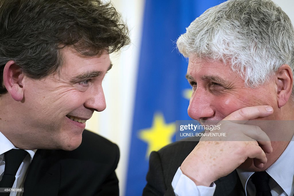French Ecology Minister <a gi-track='captionPersonalityLinkClicked' href=/galleries/search?phrase=Philippe+Martin+-+Pol%C3%ADtico&family=editorial&specificpeople=12683642 ng-click='$event.stopPropagation()'>Philippe Martin</a> (R) laughs with French Minister for Industrial Renewal Arnaud Montebourg during a press conference on the new mining code project on December 10, 2013 in Paris. AFP PHOTO / LIONEL BONAVENTURE