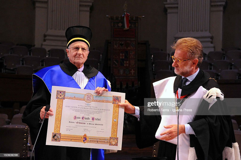 French economist Jean Claude Trichet (L) awardered with a degree of Statistic Siences Ivano Dionigi (R) Rector of the University of Bologna on September 17, 2012 in Bologna, Italy.