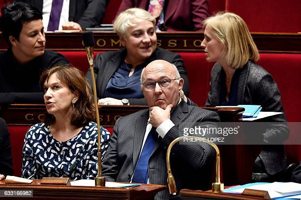 French Economy and Finance Minister Michel Sapin looks on flanked by French Minister for Family Children and Women's Rights Laurence Rossignol French...