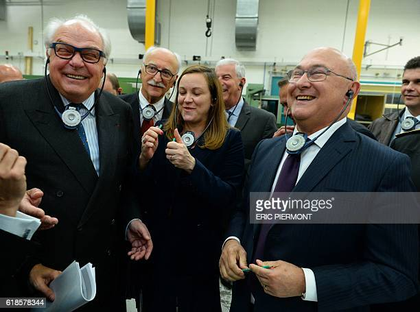 French Economy and Finance Minister Michel Sapin smiles flanked by Digital Sector and Innovation Junior Minister Axelle Lemaire and Bic Chairman...