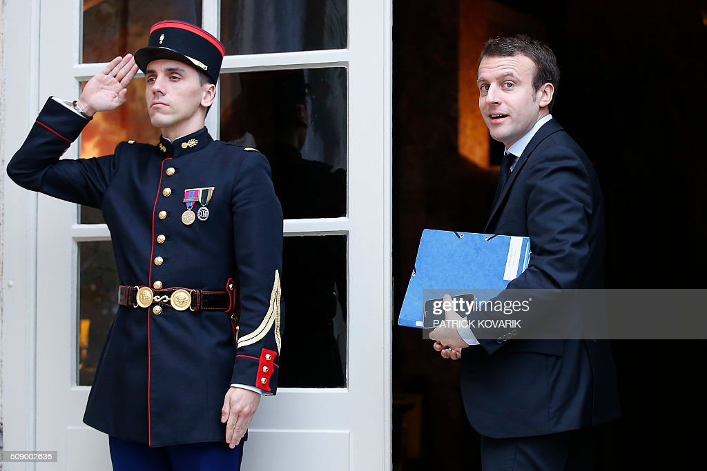 French Economy and Industry minister Emmanuel Macron arrives at the Hotel Matignon in Paris, on February 8, 2016, for a meeting with representatives of supermarkets, along with the French Prime minister and Agriculture minister, amid a crisis in France's agricultural sector. French farmers have carried out a string of demonstrations for nearly two weeks against the falling prices of their products, demanding structural measures to strengthen price rates. AFP PHOTO / PATRICK KOVARIK / AFP / PATRICK KOVARIK