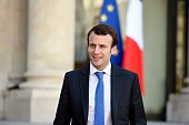 French Economy and Industry minister Emmanuel Macron arrives for a press conference after a meeting with Telecom equipment maker AlcatelLucent's...