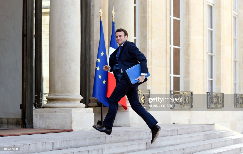 French Economy and Industry Minister <a gi-track='captionPersonalityLinkClicked' href=/galleries/search?phrase=Emmanuel+Macron&family=editorial&specificpeople=9899223 ng-click='$event.stopPropagation()'>Emmanuel Macron</a> arrives on April 13, 2015 for a meeting on employment at the presidential Elysee palace in Paris.