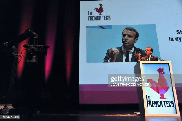 French Economy and Industry minister Emmanuel Macron delivers a speech filmed by a robot manufactured by the company Laval AR on July 25 at the...
