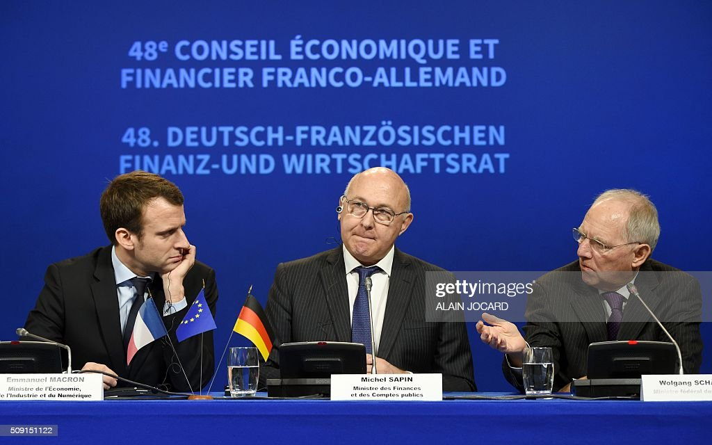 French Economy and Industry minister Emmanuel Macron, French Finance Minister Michel Sapin, and German Finance Minister Wolfgang Schauble hold a press conference during the Franco-German Economic Council, on February 9, 2016, in Paris. / AFP / ALAIN JOCARD