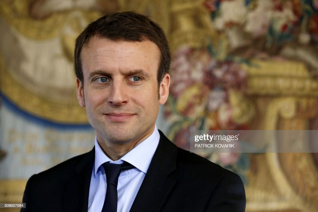 French Economy and Industry minister Emmanuel Macron is pictured during a press conference following a meeting amid a crisis in France's agricultural sector in Paris on February 8, 2016. French farmers have carried out a string of demonstrations for nearly two weeks against the falling prices of their products, demanding structural measures to strengthen price rates. / AFP / PATRICK KOVARIK