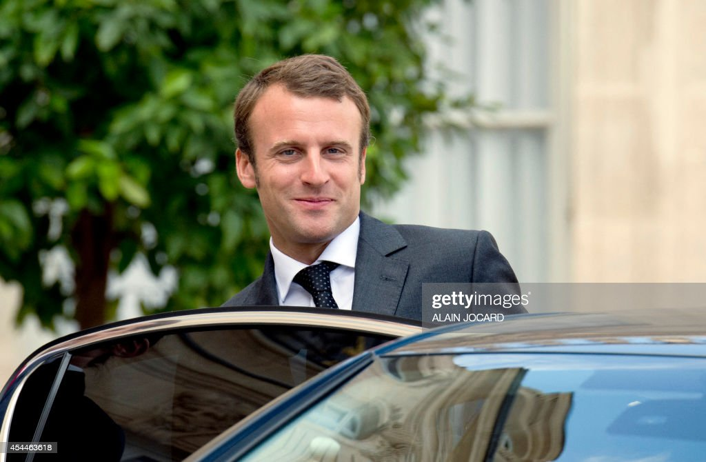 French Economy and Industry minister Emmanuel Macron, leaves after a meeting with regions prefects and regional administration managers on September 1, 2014, at the Elysee palace in Paris.