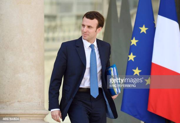 French Economy and Industry minister Emmanuel Macron leaves the Elysee Palace at the end of the cabinet meeting on April 15 2015 in Paris AFP PHOTO...