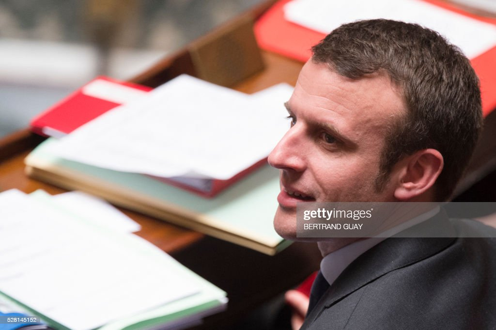 French Economy and Industry minister Emmanuel Macron looks on during a session of questions to the Government, on May 4, 2016 at the French National Assembly in Paris. / AFP / BERTRAND