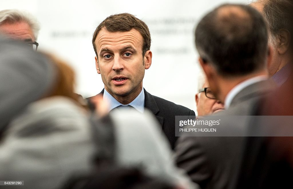 French Economy and Industry minister Emmanuel Macron speaks as he visits Aperam's stainless facilities in Isbergues, northern France, on June 27, 2016. / AFP / PHILIPPE