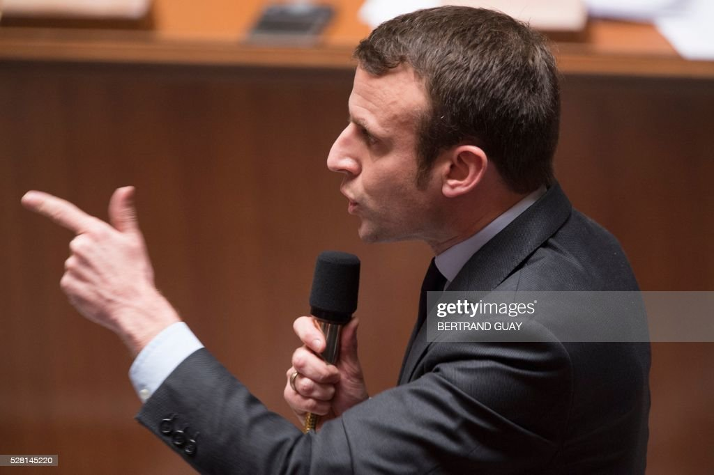 French Economy and Industry minister Emmanuel Macron speaks during a session of questions to the Government on May 4, 2016 at the French National Assembly in Paris. / AFP / BERTRAND