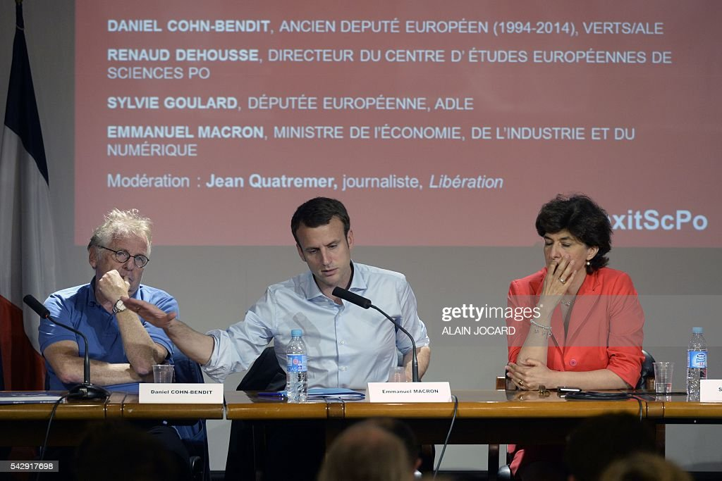 French Economy and Industry minister Emmanuel Macron (C) speaks next to French and German former European parliamentarian and ecologist Daniel Cohn-Bendit (L) and European Parliament Member Sylvie Goulard (R) during a symposium named 'Where Europe is going after Britain's referenda' organized on June 25, 2016 at the Institute of Political Science (Sciences Po) in Paris. / AFP / ALAIN